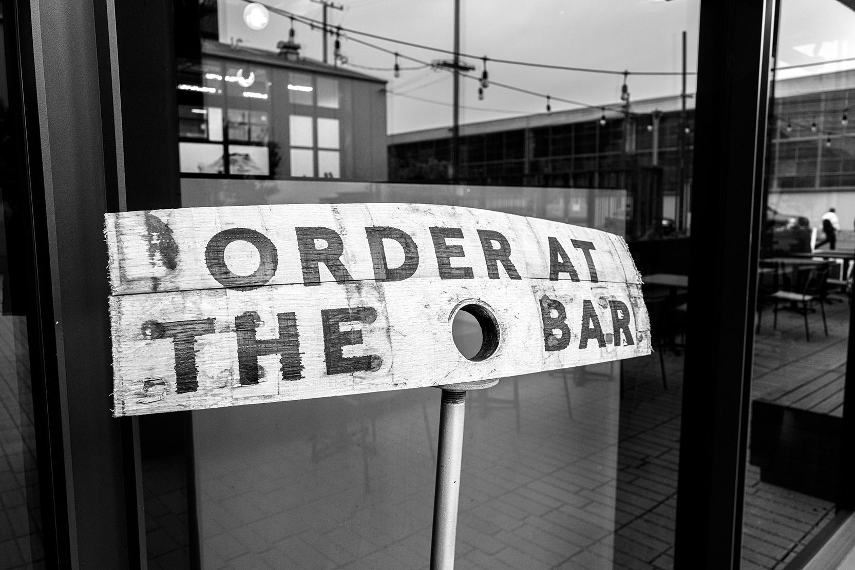 Seven Stills Order at the Bar sign